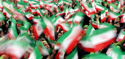 Students celebrate the 30th anniversary of the Islamic Revolution in Tehran.