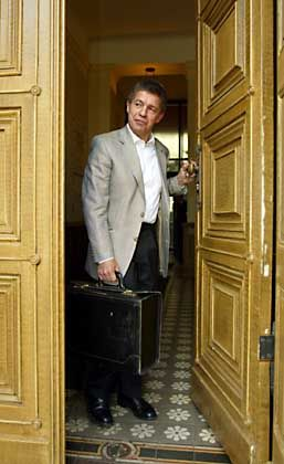 Joachim Sauer caught at his door.
