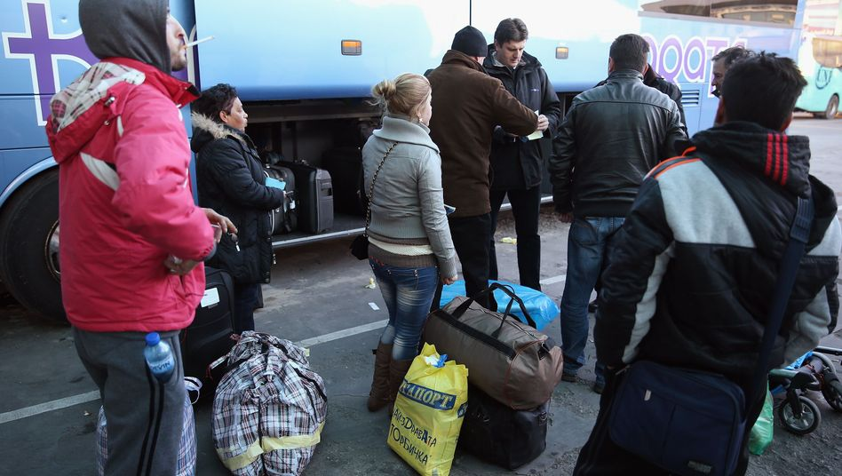 Passengers in Sofia, Bulgaria board a bus destined for Germany in 2008.