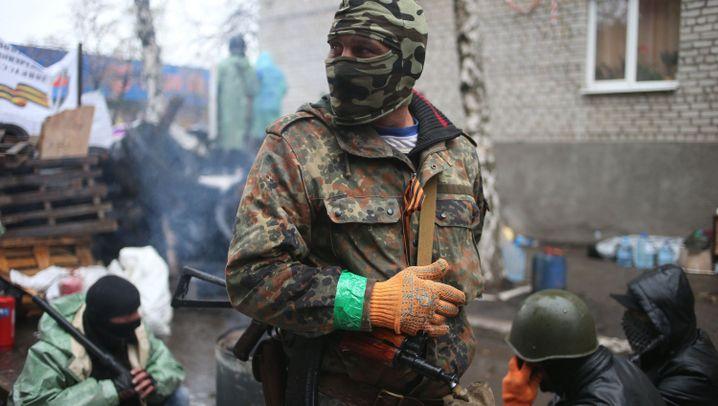 Fotostrecke: Tote und Verletze in der Ostukraine