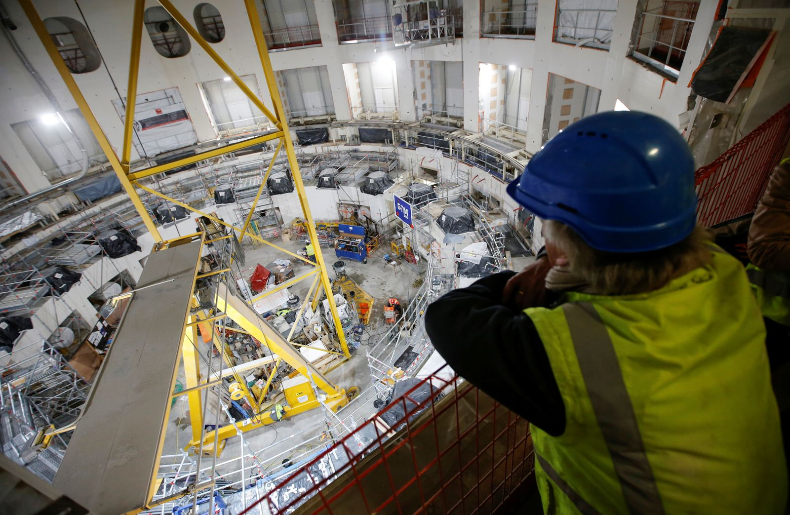 A technician looks at the circular bioshield inside the construction site of the International Thermonuclear Experimental Reactor (ITER) in Saint-Paul-lez-Durance