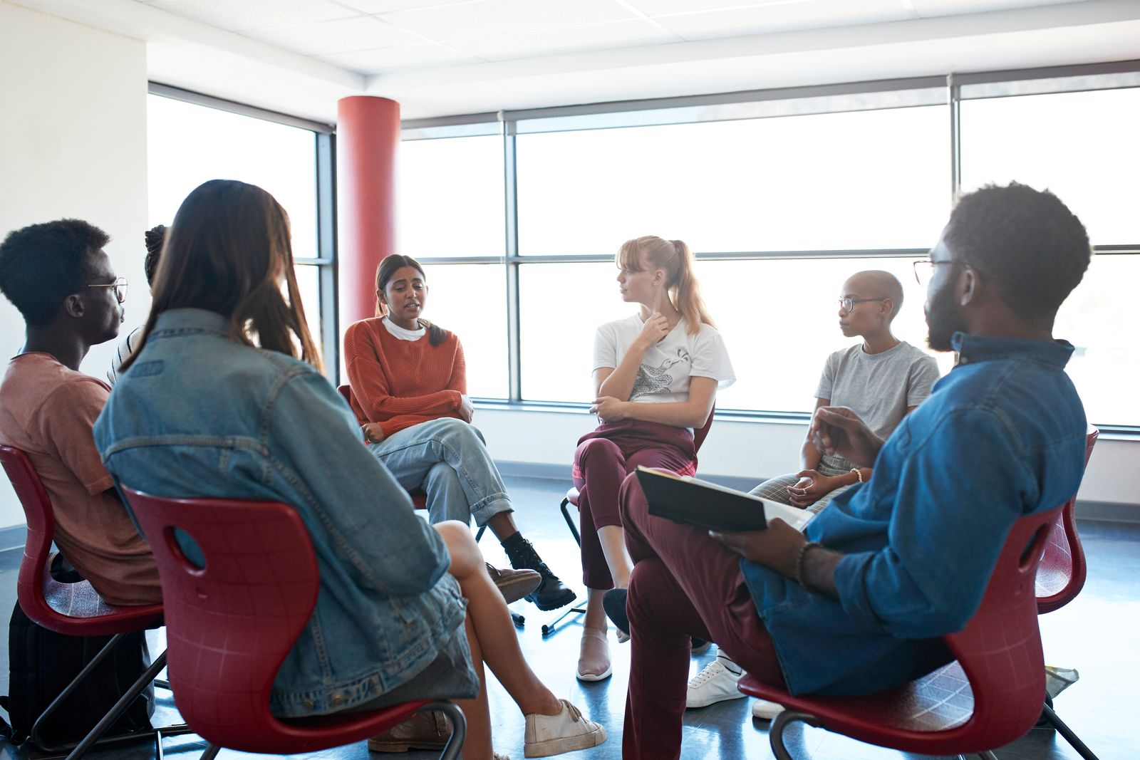 Sad woman sharing with friends and instructor