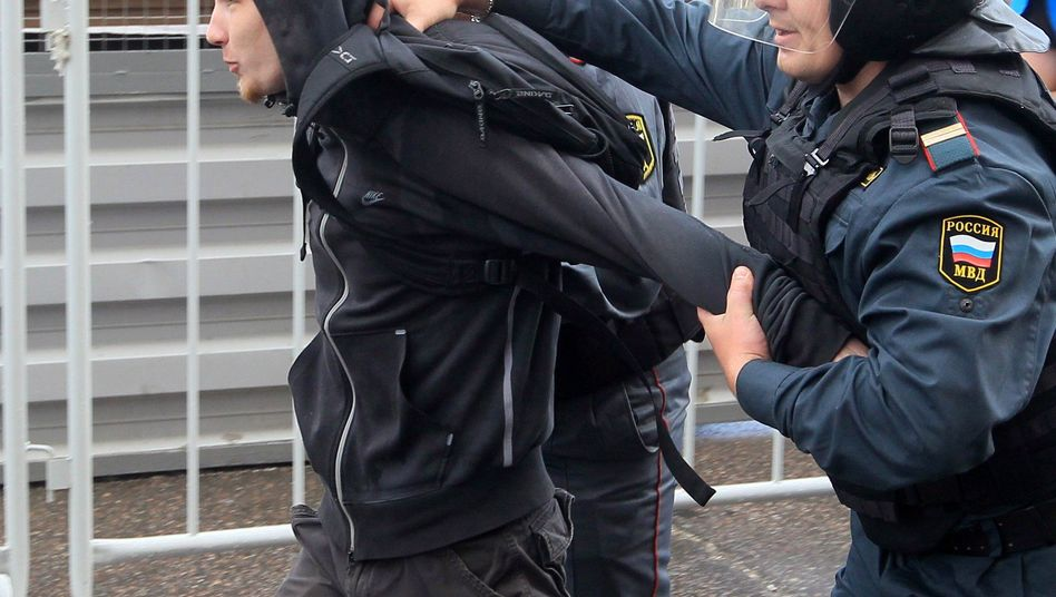 Riot police detain a participant in an unauthorized protest in Moscow on May 31. A new Russian law will restrict the right to demonstrate.
