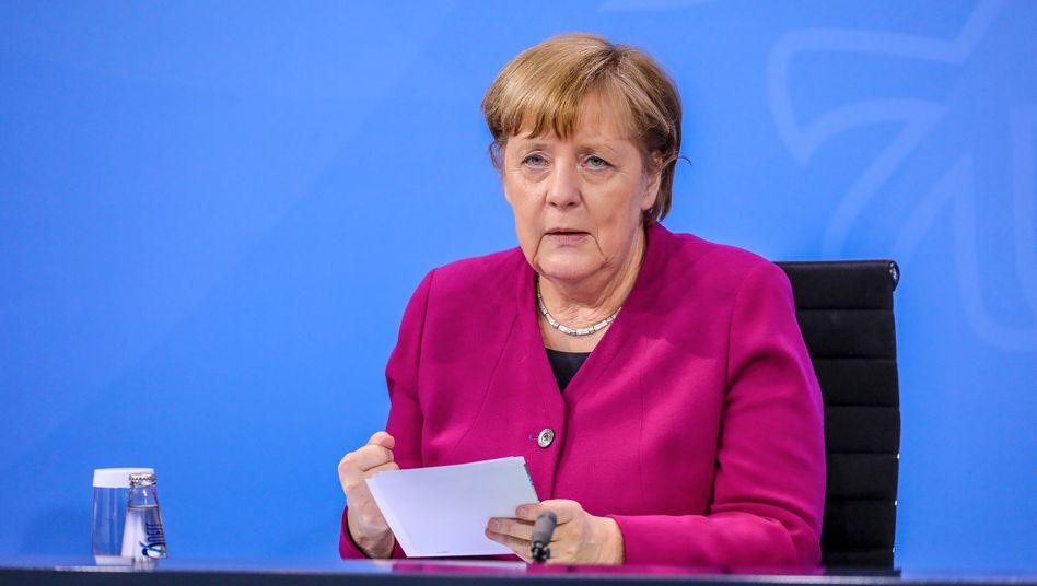 Angela Merkel bei einer Pressekonferenz nach den Bund-Länder-Beratungen