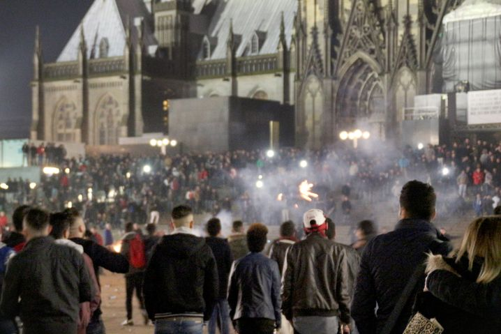 Hundreds of people can be seen here celebrating the New Year on the square located between Cologne's central station and the city's world-famous cathedral. Dozens of women reported they had been attacked or sexually harrassed at the site.