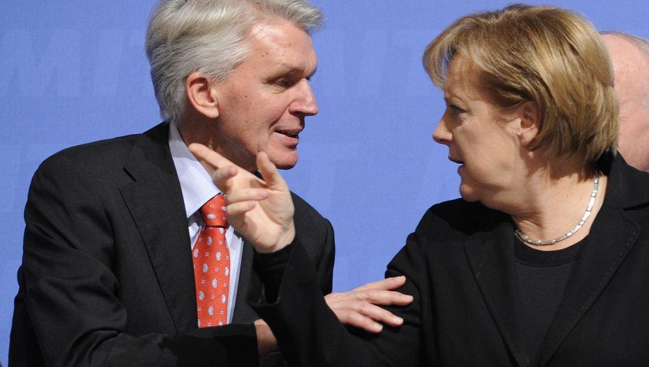 CDU-Politiker Schlarmann und Merkel: Wann kommt die geplante Steuersenkung?