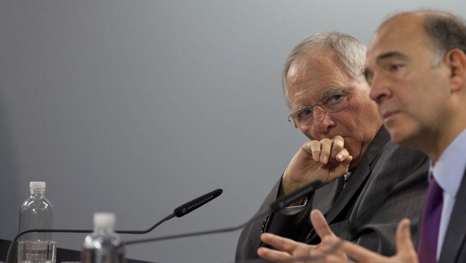 Finanzminister Schäuble und Pierre Moscovici: Gemeinsame Haltung gegen Schuldenschnitt