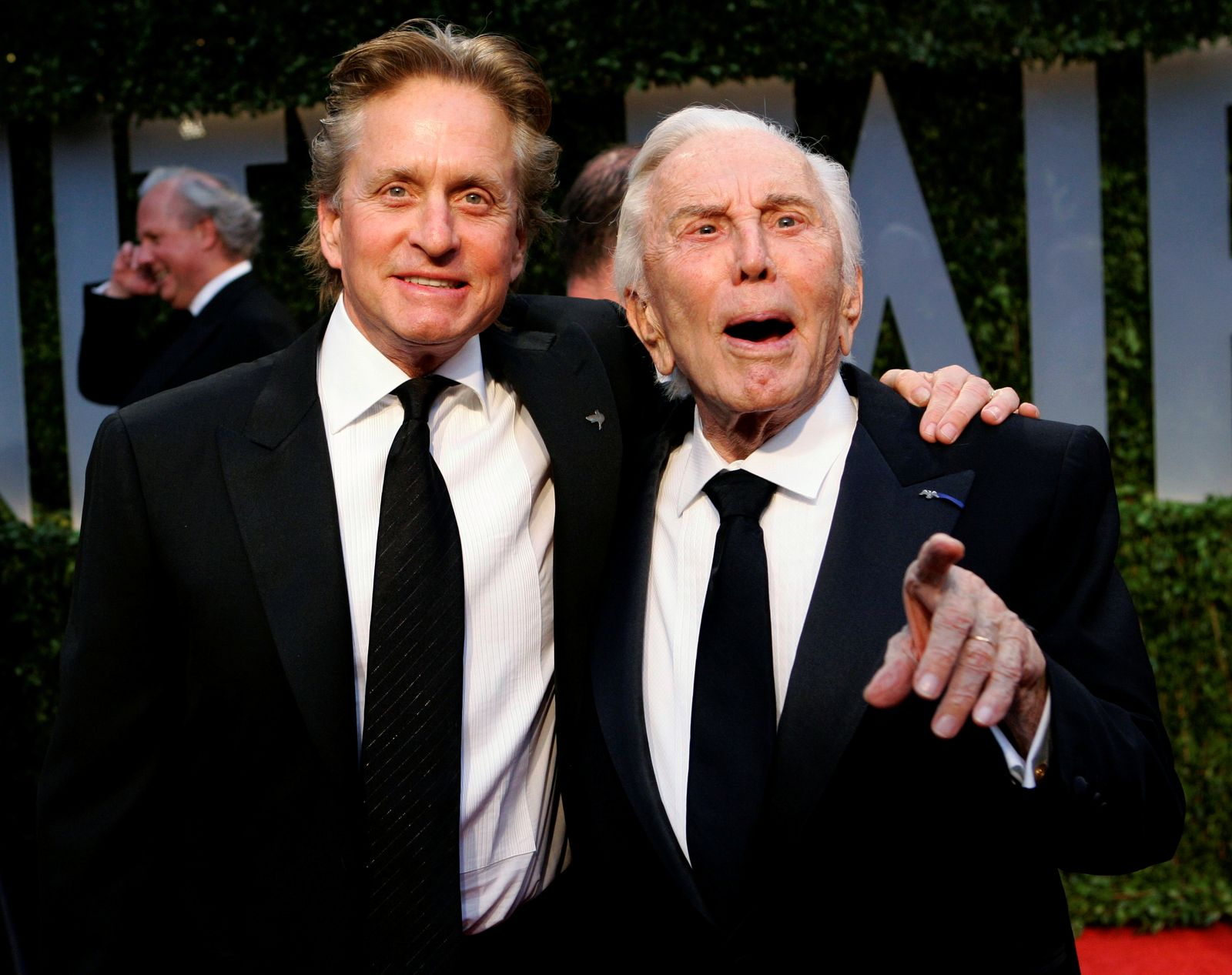 FILE PHOTO: Actor Michael Douglas and his father, actor Kirk Douglas, arrive together at the 2009 Vanity Fair Oscar Party in West Hollywood, California