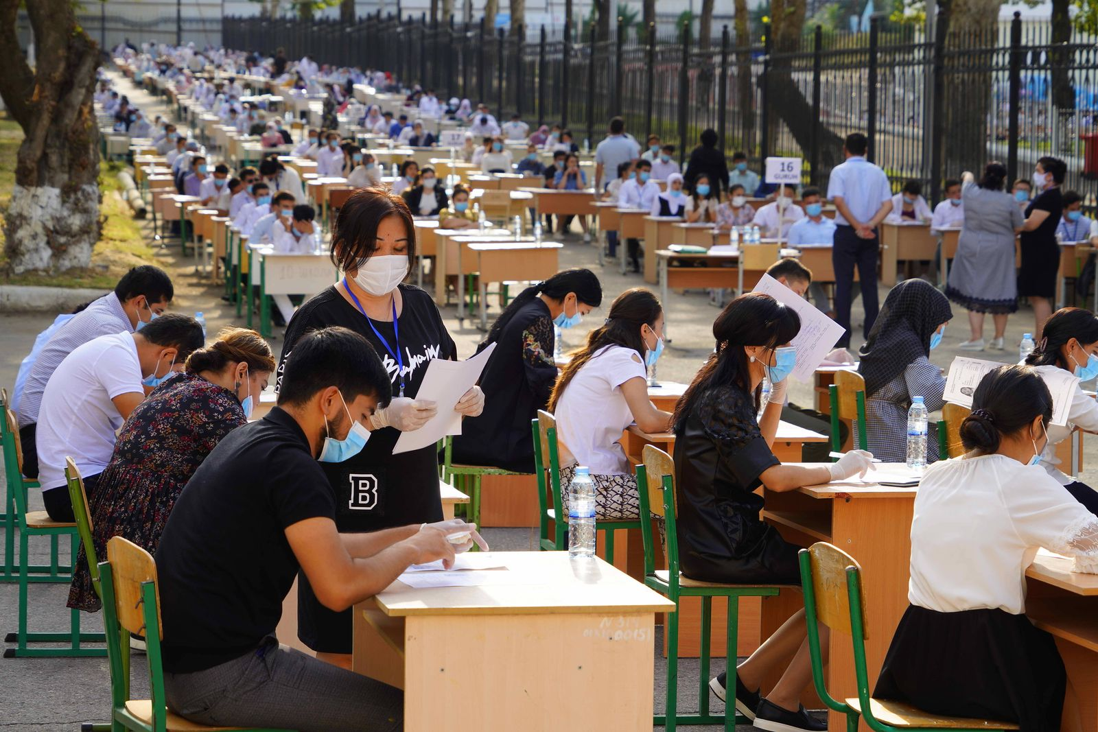 (200902) -- TASHKENT, Sept. 2, 2020 -- Students attend the university entrance examination at an outdoor exam site in Ta