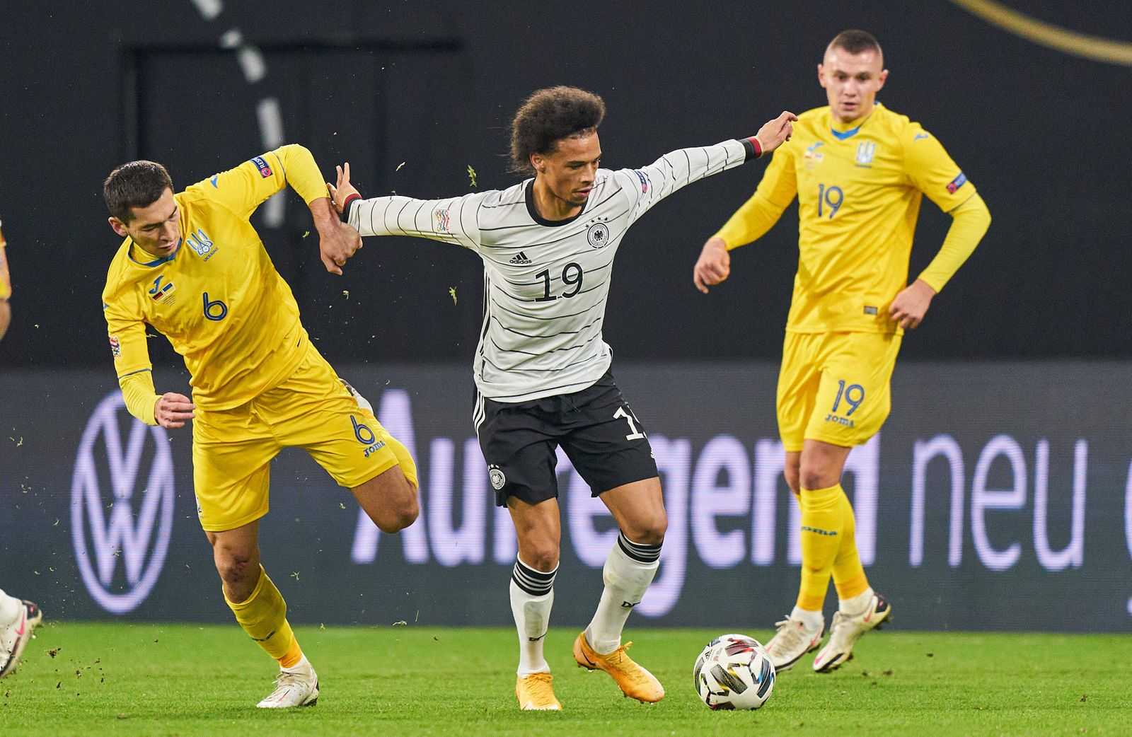 Leroy SANE, DFB 19 compete for the ball, tackling, duel, header, zweikampf, action, fight against Taras STEPANENKO, UKR