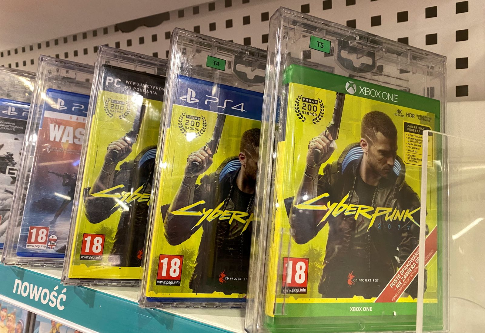 Boxes with CD Projekt's game Cyberpunk 2077 are displayed in Warsaw