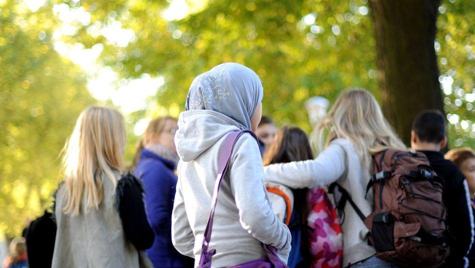 Schülerin mit Kopftuch: Viele Jugendliche mit Migrationshintergrund bekommen keinen Ausbildungsplatz