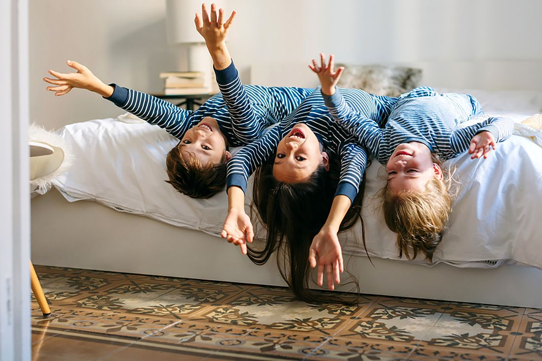 Kids Playing On Bed In The Morning.
