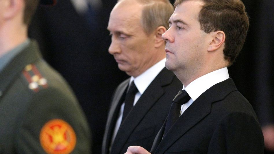Russian Prime Minister Vladimir Putin and President Dmitry Medvedev: The US thinks it knows who is pulling the strings.
