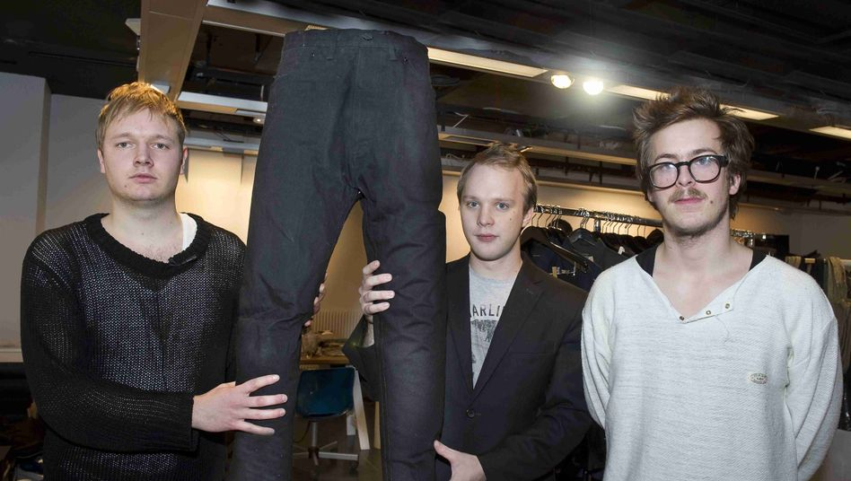 Noko Jeans founders, from left to right, Jakob Ohlsson, Tor Rauden Källstigen and Jacob Aström with a pair of their jeans produced in North Korea.