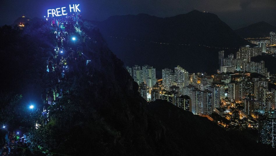 Protesters on a hill above Hong Kong