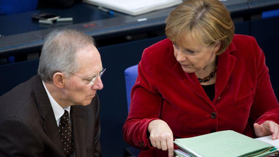 """Schäuble und Merkel: """"Geht nicht um Steuergelder, sondern um einen Kredit"""""""