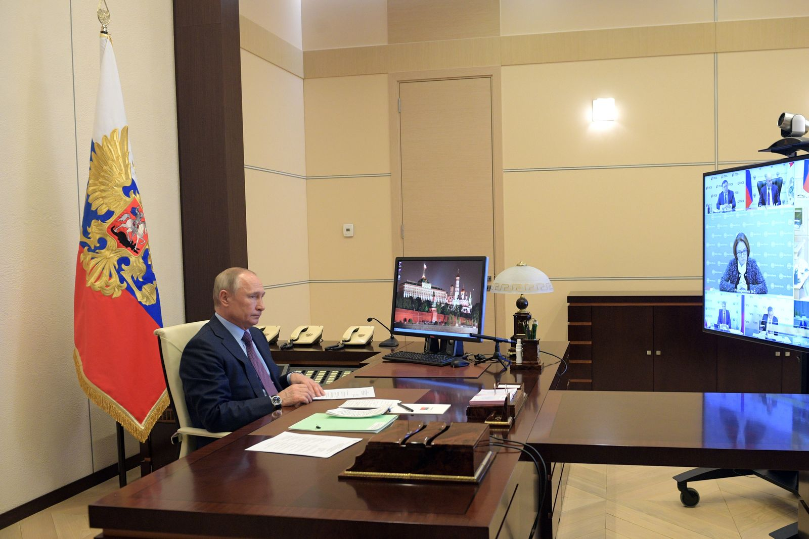 Russian President Putin chairs a meeting via a video link outside Moscow