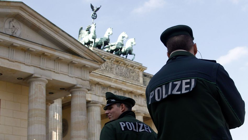 Tourists targeted: Policemen patroling next to the Brandenburg Gate in Berlin.