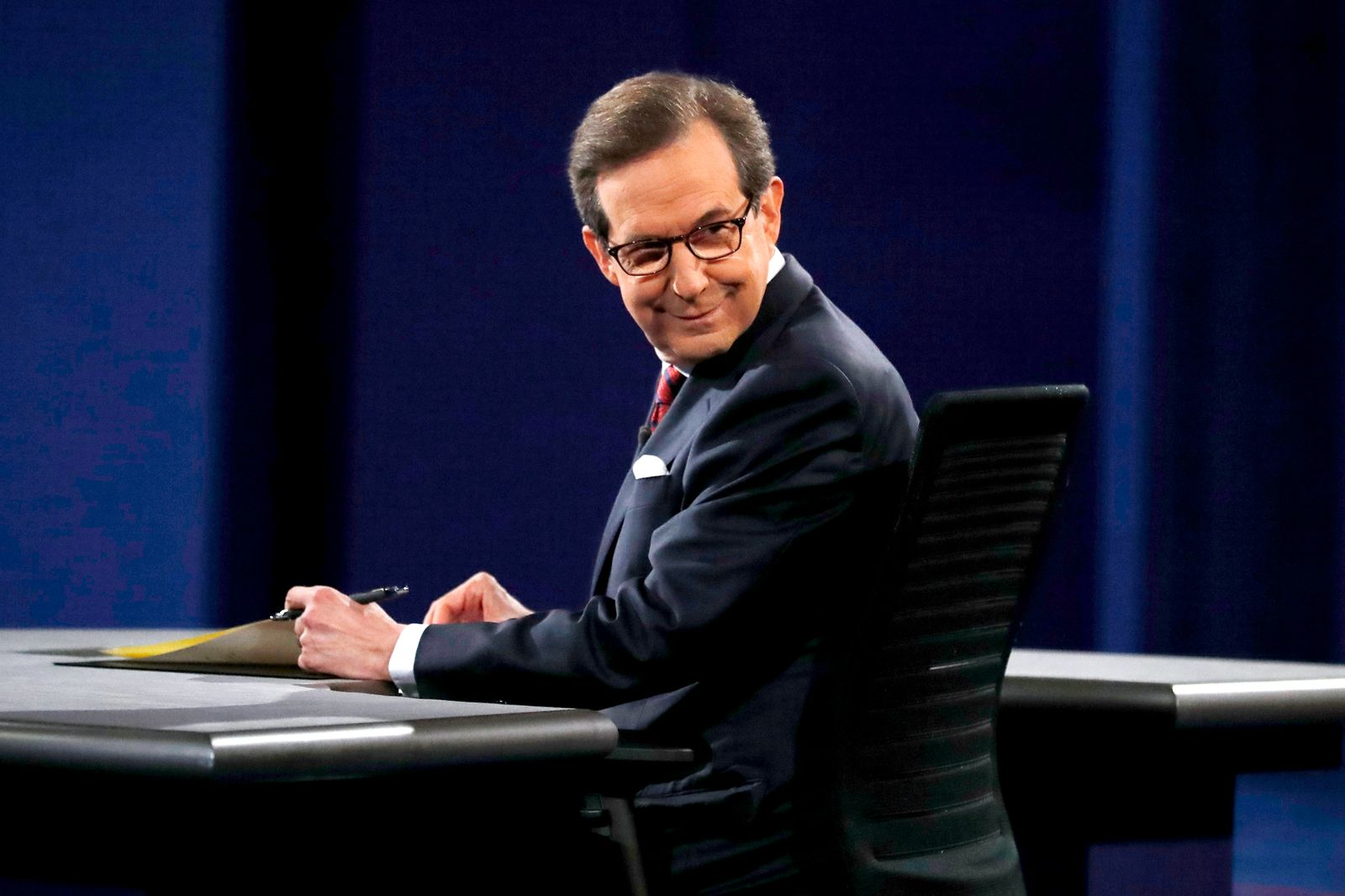 Debate moderator Chris Wallace smiles back at the audiencee before Trump and Clinton's third and final 2016 presidential campaign debate at UNLV in Las Vegas