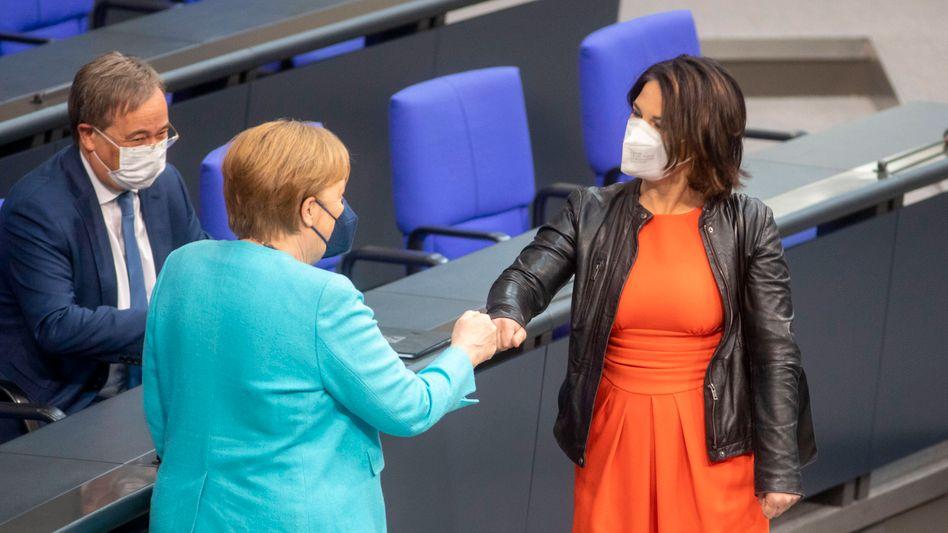 Laschet, Merkel und Baerbock
