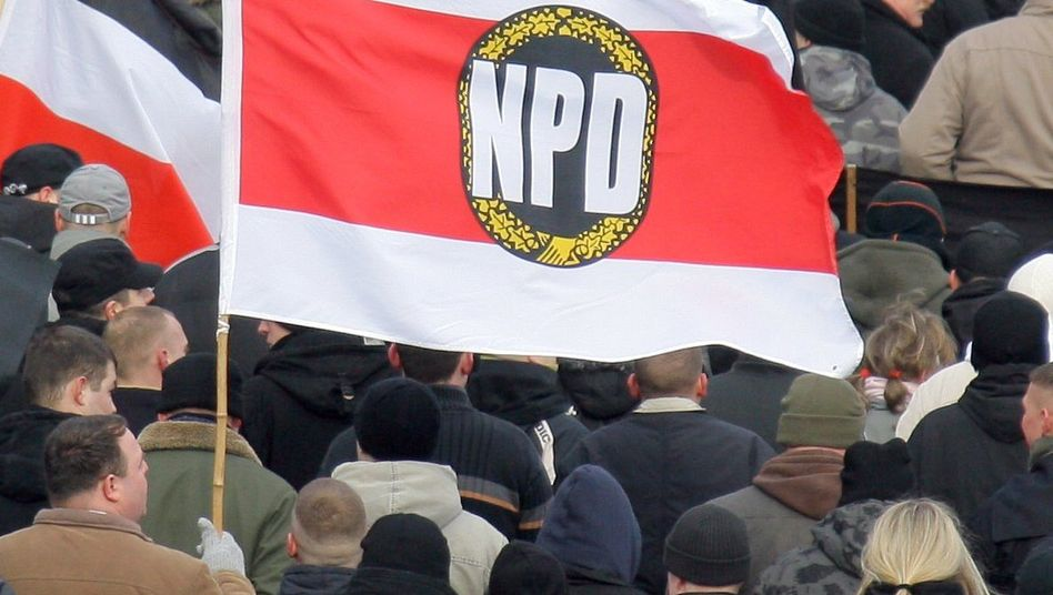 Right-wing extremists waving the NPD flag at a far-right demonstration in Dresden this year.