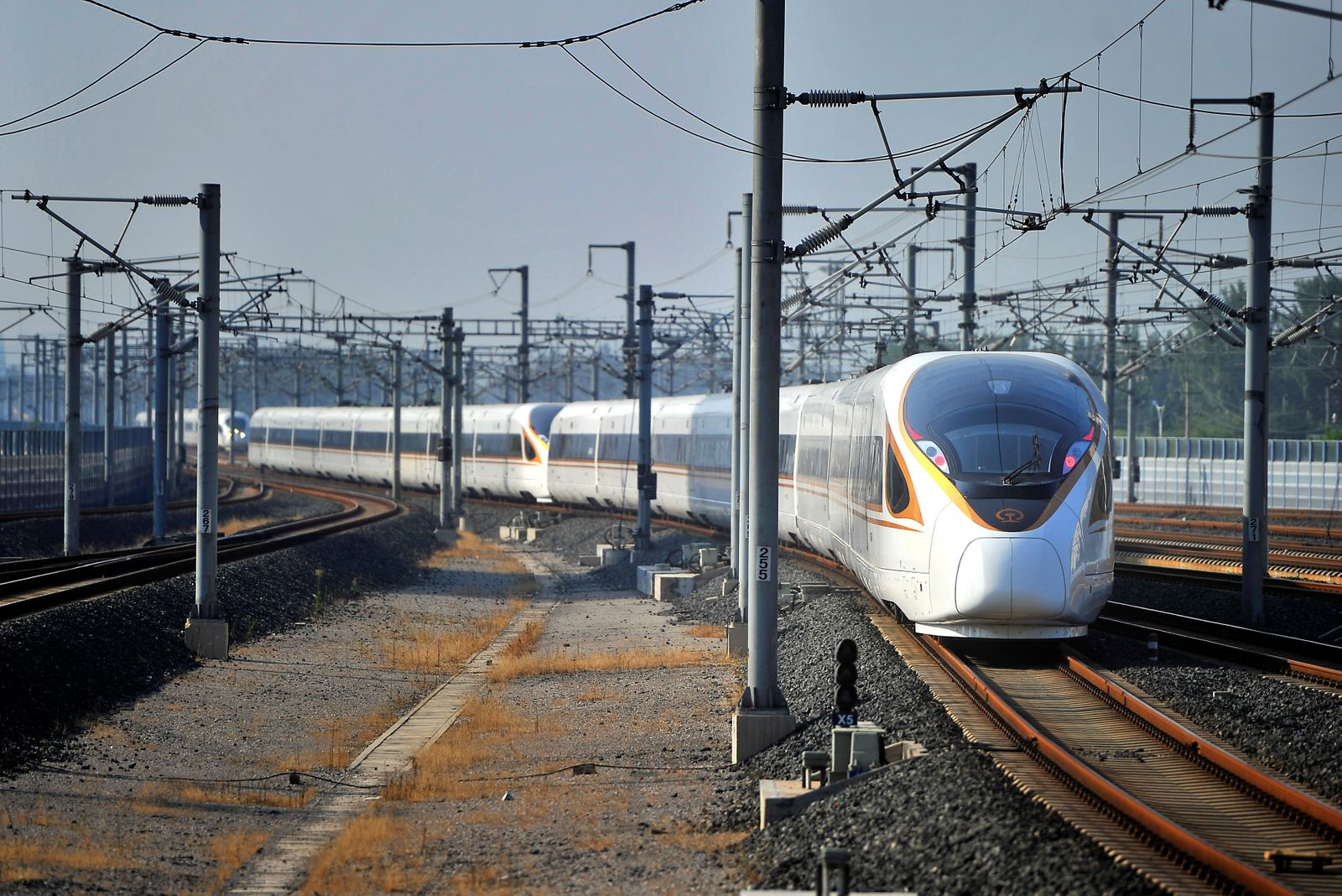 Fuxing bullet train travelling from Beijing to Shanghai arrives at Jinan West Railway Station