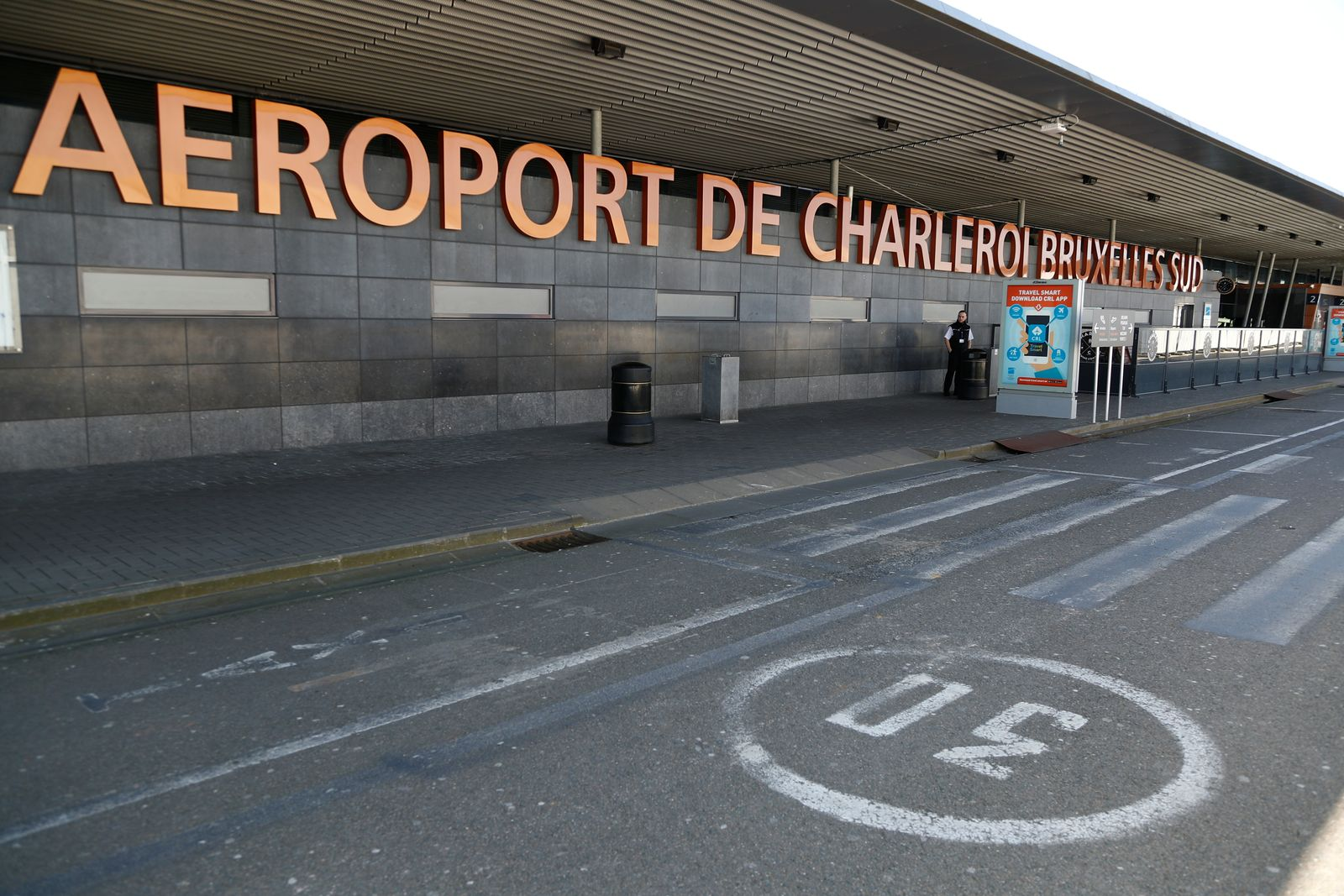 An empty entrance is pictured before the closure of Brussels South Charleroi Airport as airlines have suspended flights to slow down the spread of coronavirus disease (COVID-19), Charleroi