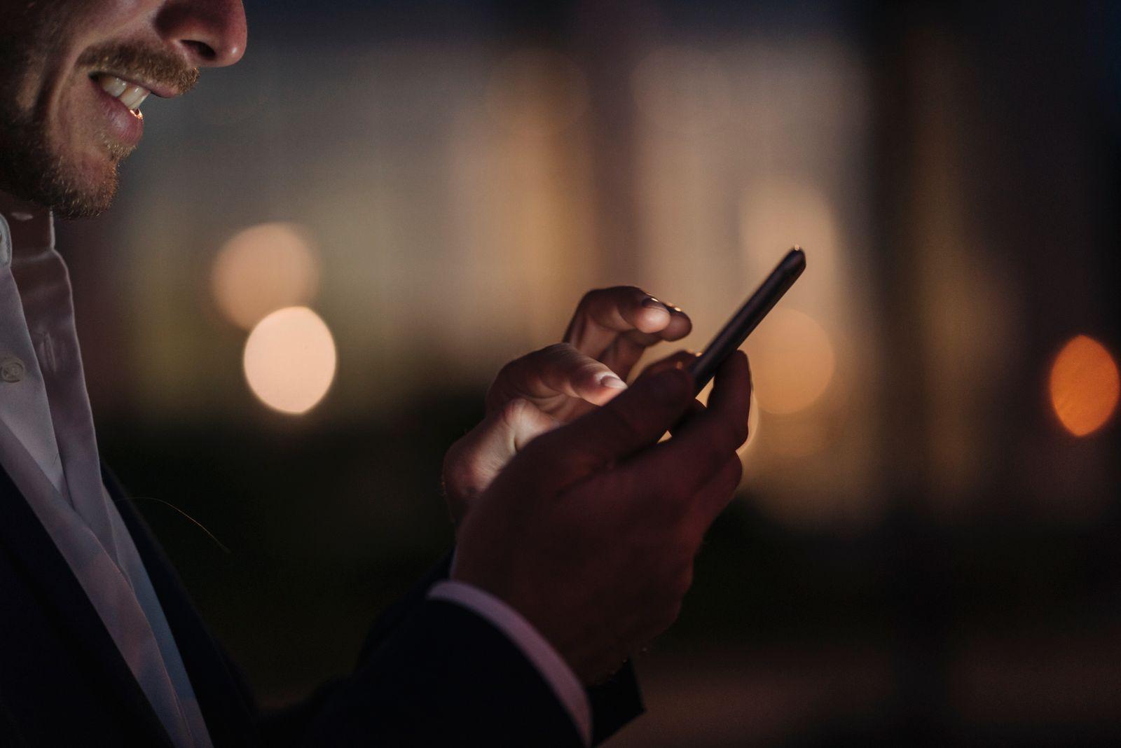 Close-up of businessman text messaging