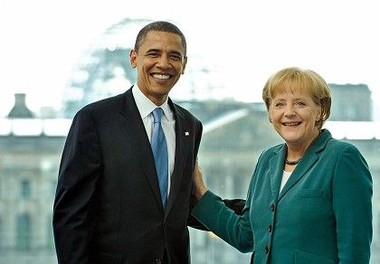 Angela Merkel with Barack Obama pose for the cameras at their first meeting in Berlin in July 2008.