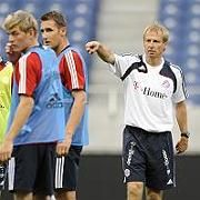Klinsmann works with his team during a practice session on Wednesday.