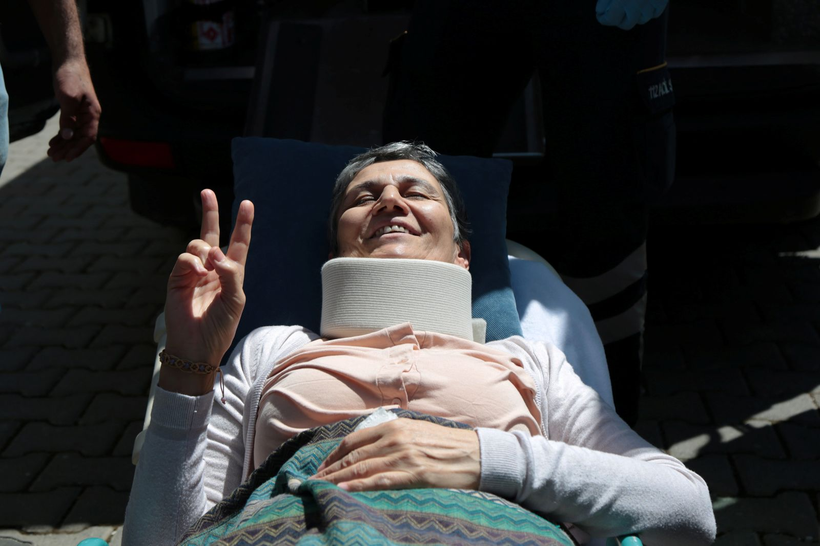Pro-Kurdish HDP lawmaker Guven, who ends her hunger strike after a call from jailed militant leader Ocalan, leaves her home to go to hospital in Diyarbakir