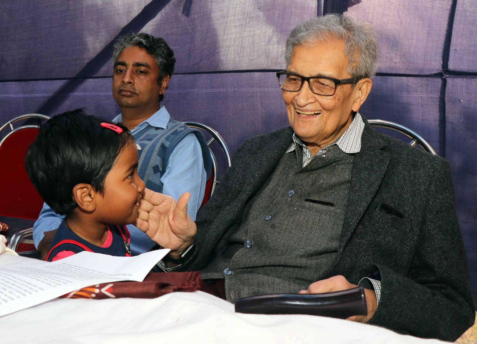 India Nobel laureate Amartya Sen Nobel laureate Amartya Sen interacts with a child during a program