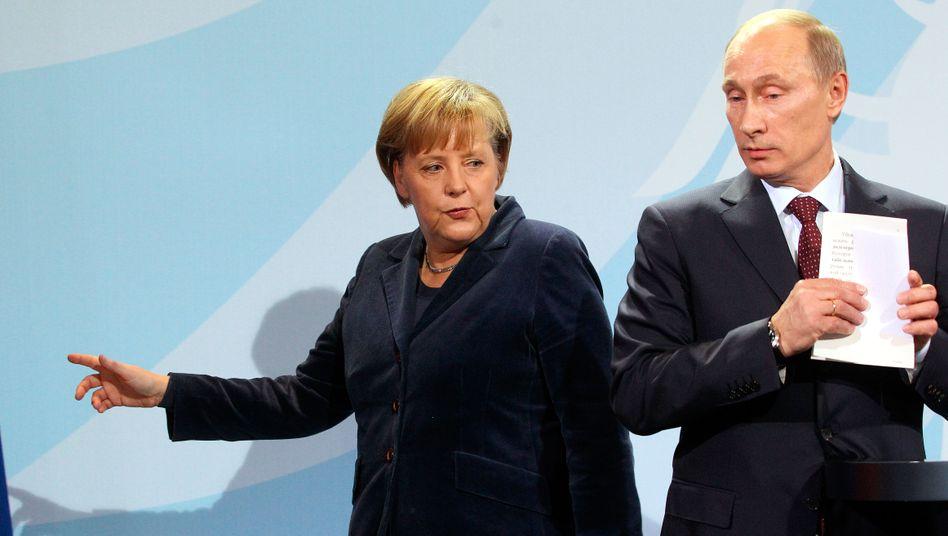Kanzlerin Merkel und Präsident Putin: Taktieren und abwarten
