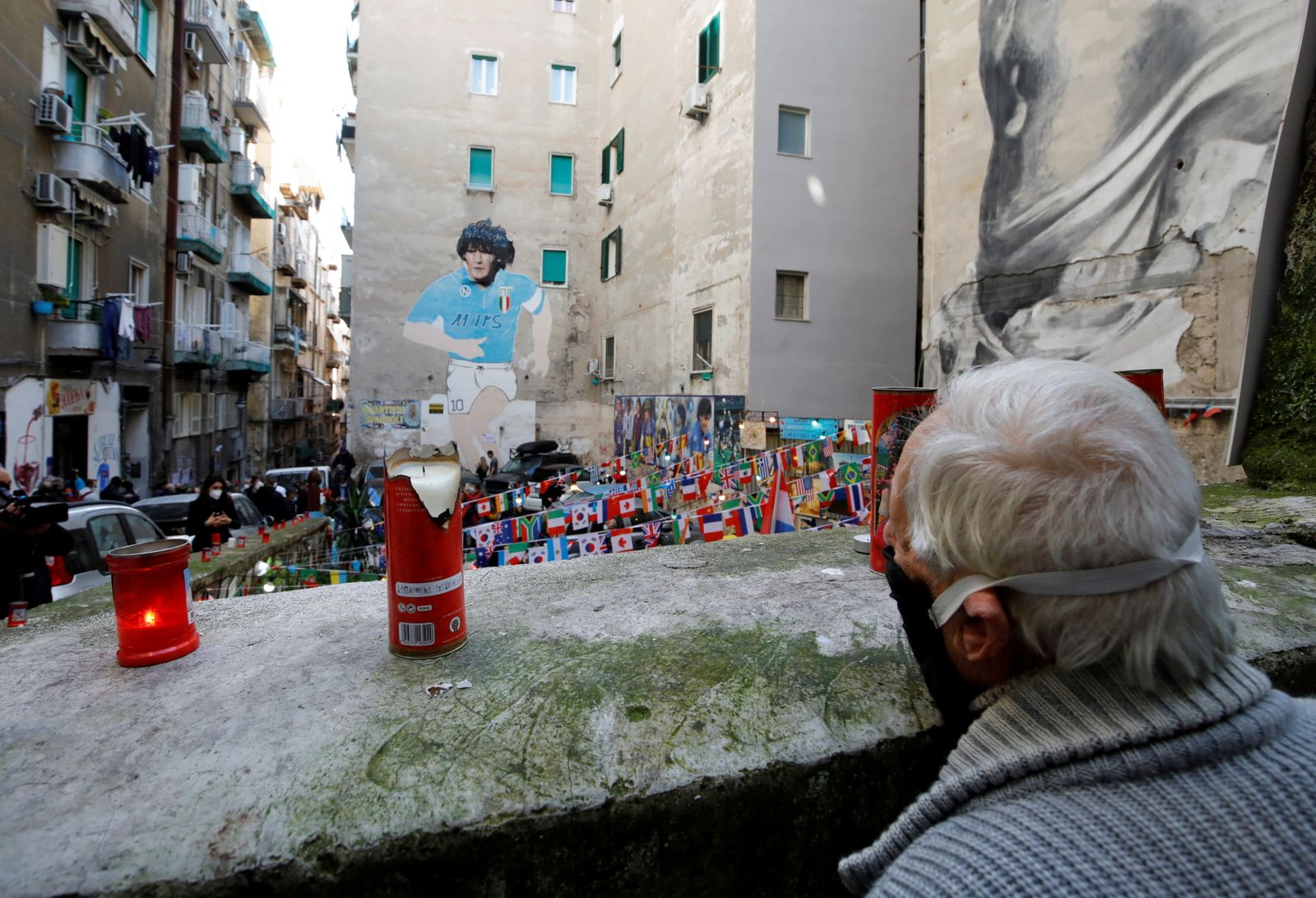 People gather to mourn the death of Argentine soccer legend Diego Maradona in Naples