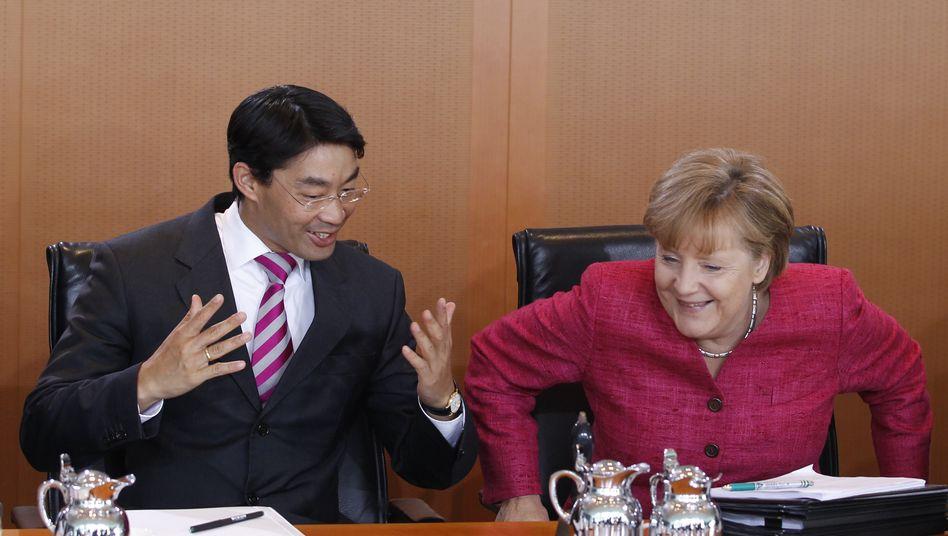Koalitionspartner Rösler, Merkel: Offenbar Einigung auf Steuerreform