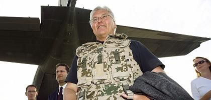 Looking forward to life with Barack Obama: German Foreign Minister Frank-Walter Steinmeier, wearing a bullet-proof vest, during a trip to Afghanistan in August.