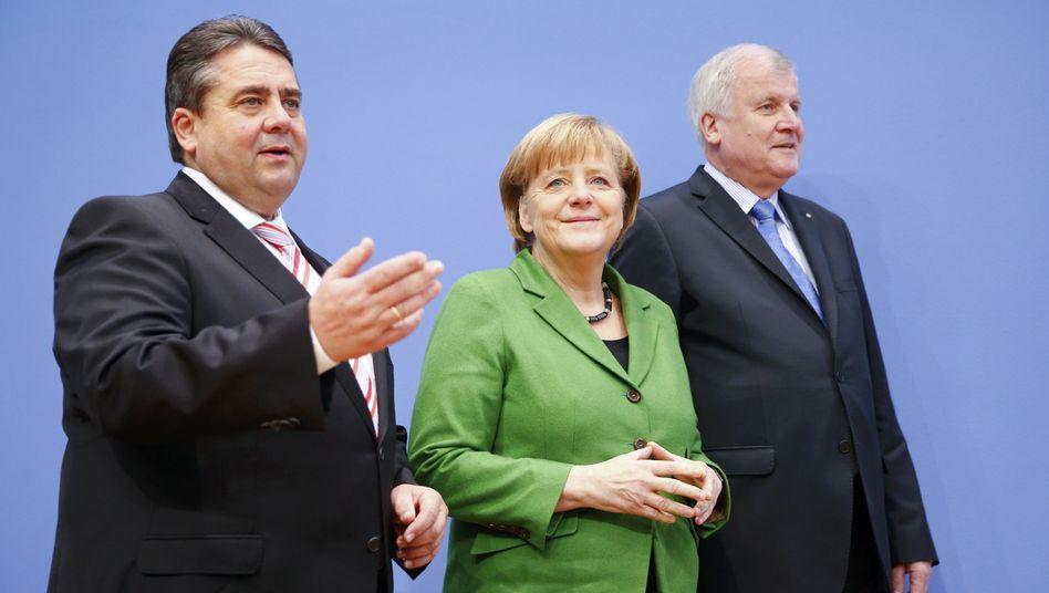 Wachsen zusammen: Parteichefs Gabriel, Merkel und Seehofer