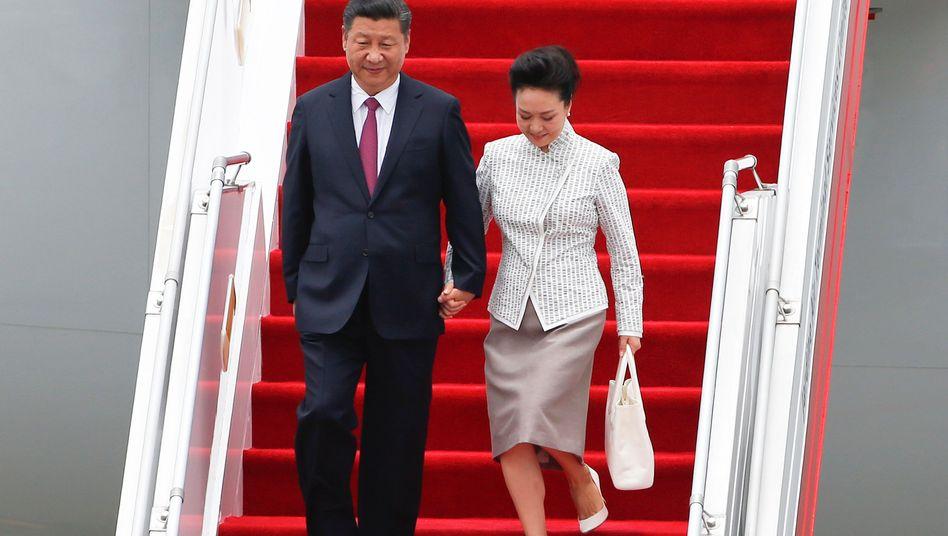 Staatschef Xi Jinping mit seiner Frau Peng Liyuan