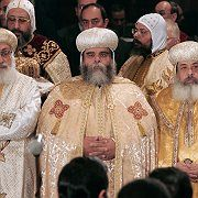 "Pope Shenuda III (center) at a Coptic mass in Cairo: ""Begin neither quarrels nor disputes."""