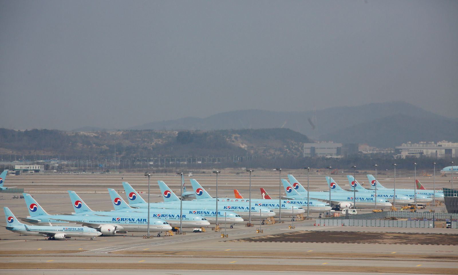 Korean Air's passenger planes are parked following outbreak of COVID-19, at Incheon International Airport