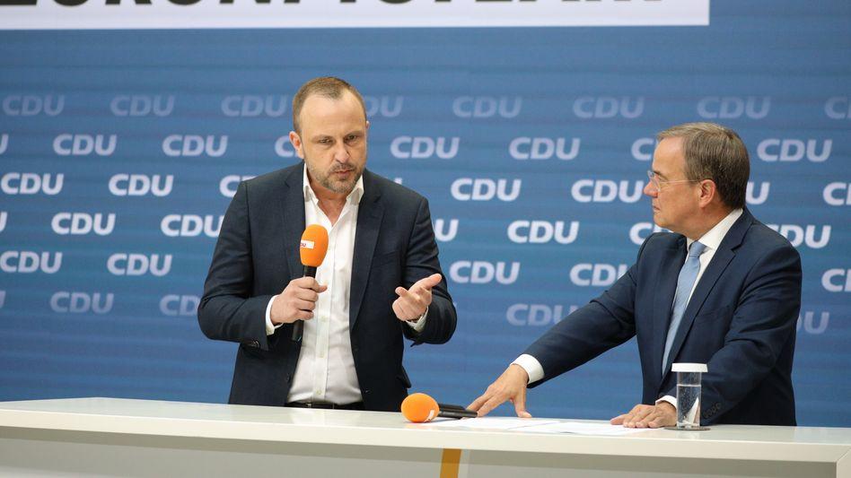 Kanzlerkandidat Laschet (r.) mit seinem Sicherheitsexperten Neumann: »Strategischer Ansatz«