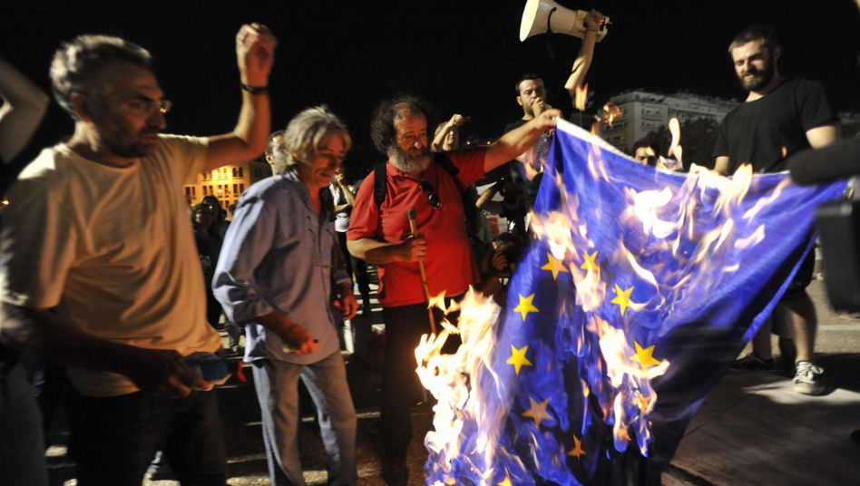 Protesters burn an European Union flag in Greece last month.