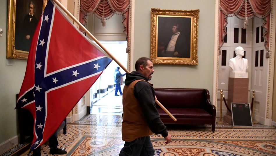A Trump supporter carrying a Confederate flag through the U.S. Capitol on Wednesday.