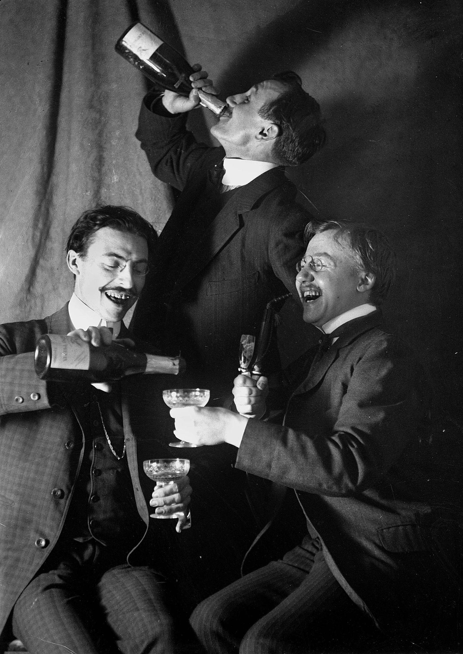 Three men drinking some champagne,