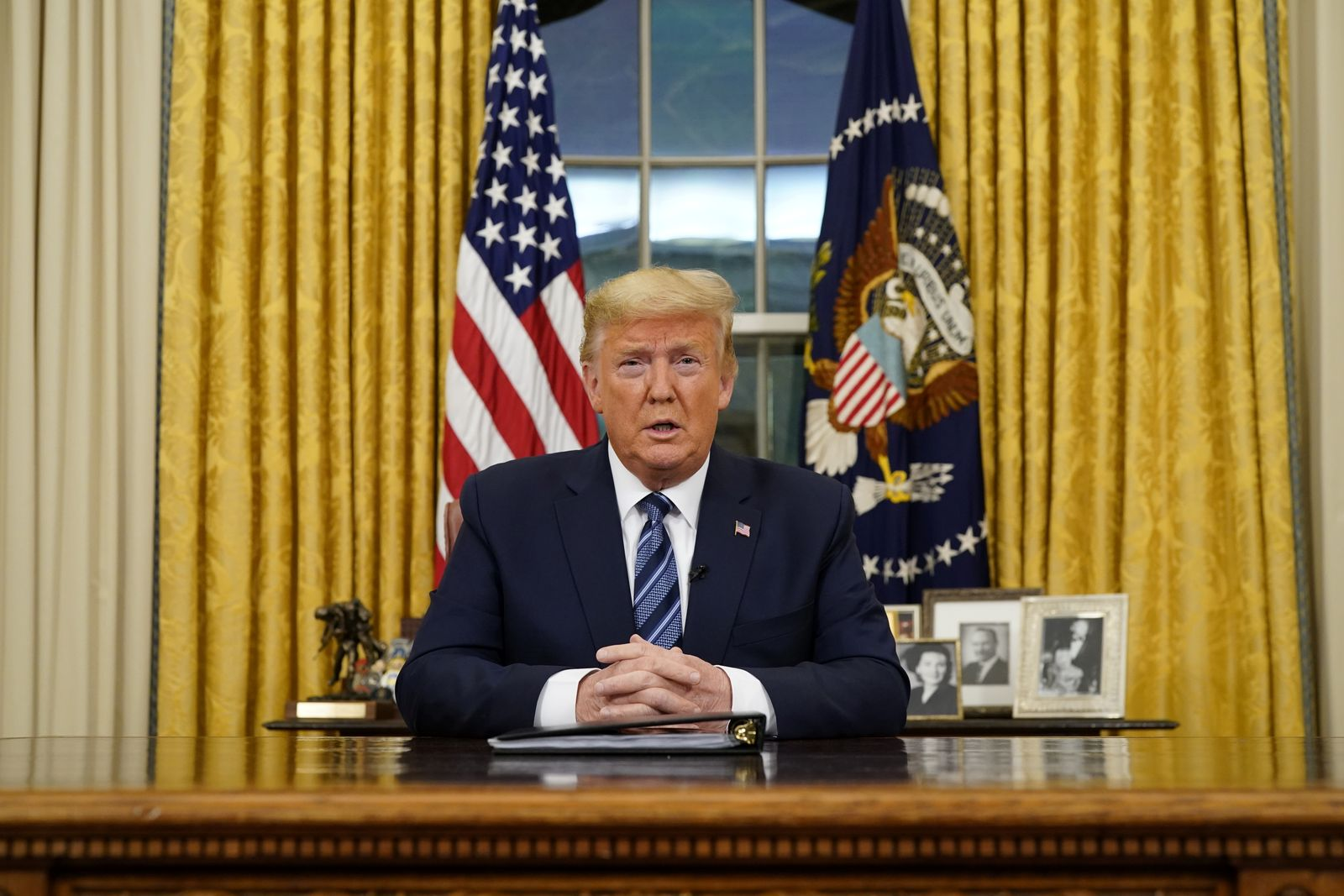 U.S. President Trump speaks about the U.S response to the COVID-19 coronavirus pandemic during an address to the nation from the Oval Office of the White House