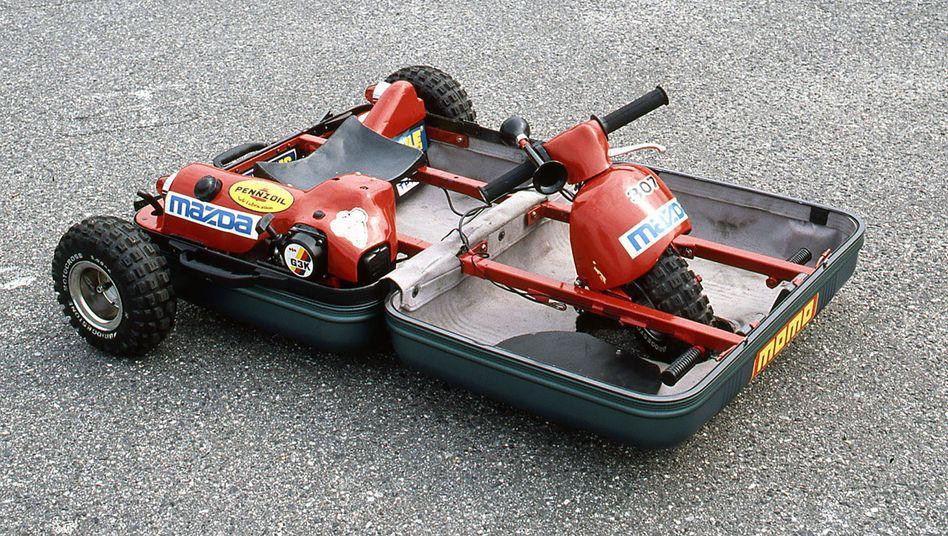 Aufklappen, Platz nehmen, losfahren: Einige Mazda-Ingenieure verwandelten 1990 einen Koffer in einen Kleinstwagen
