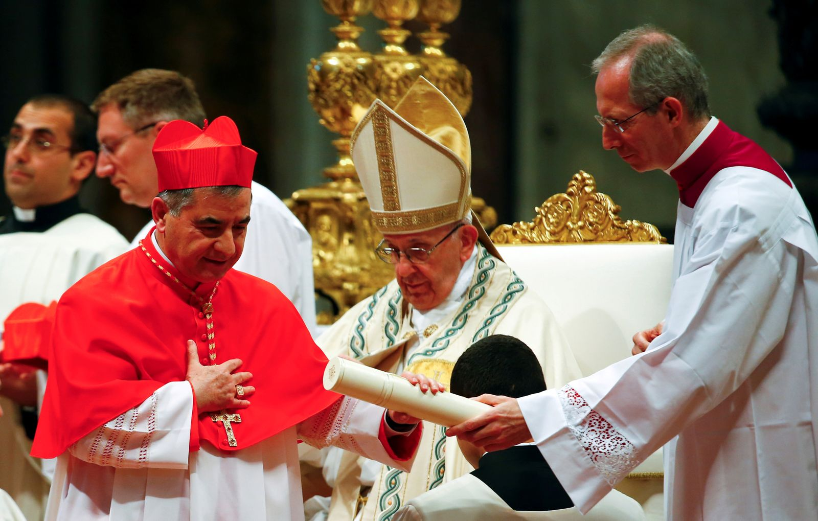 FILE PHOTO: New cardinal Giovanni Angelo Becciu of Italy is seen during a consistory ceremony to install 14 new cardinals in Saint Peter's Basilica at the Vatican