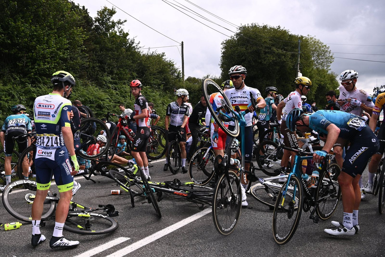 LANDERNEAU, FRANCE - JUNE 26 : crash of the peleton during stage 1 of the 108th edition of the 2021 Tour de France cycl
