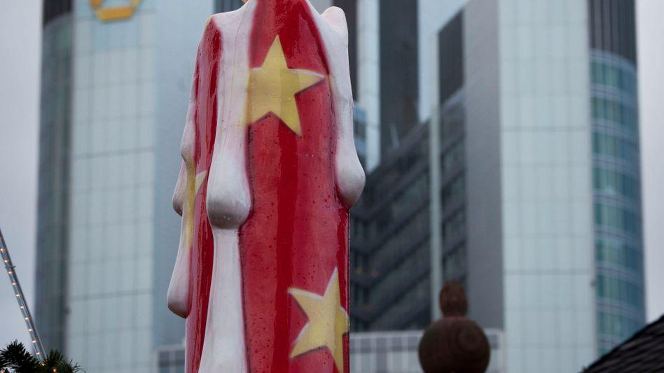 Kerze vor der Commerzbank-Zentrale: Sparen ist angesagt